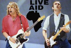 Parfitt e Rossi durante a antológica apresentação do Status Quo no Live Aid crédito: http://www.rankopedia.com/CandidatePix/94109.gif